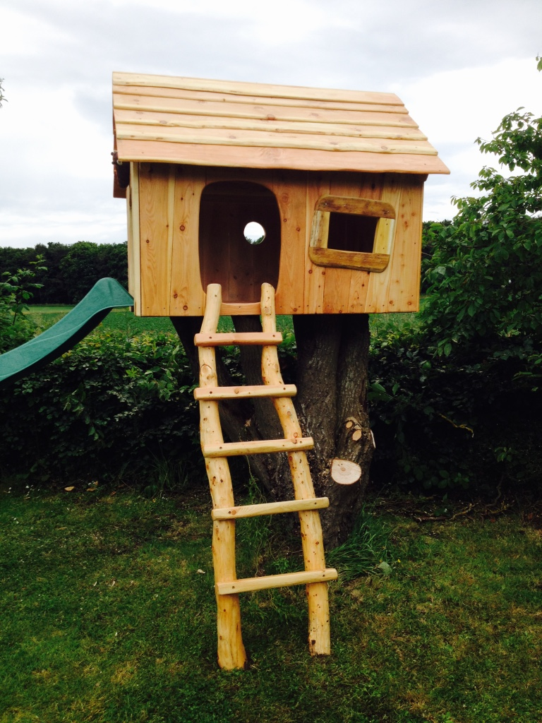 childrens tree house with slide wildchild designs
