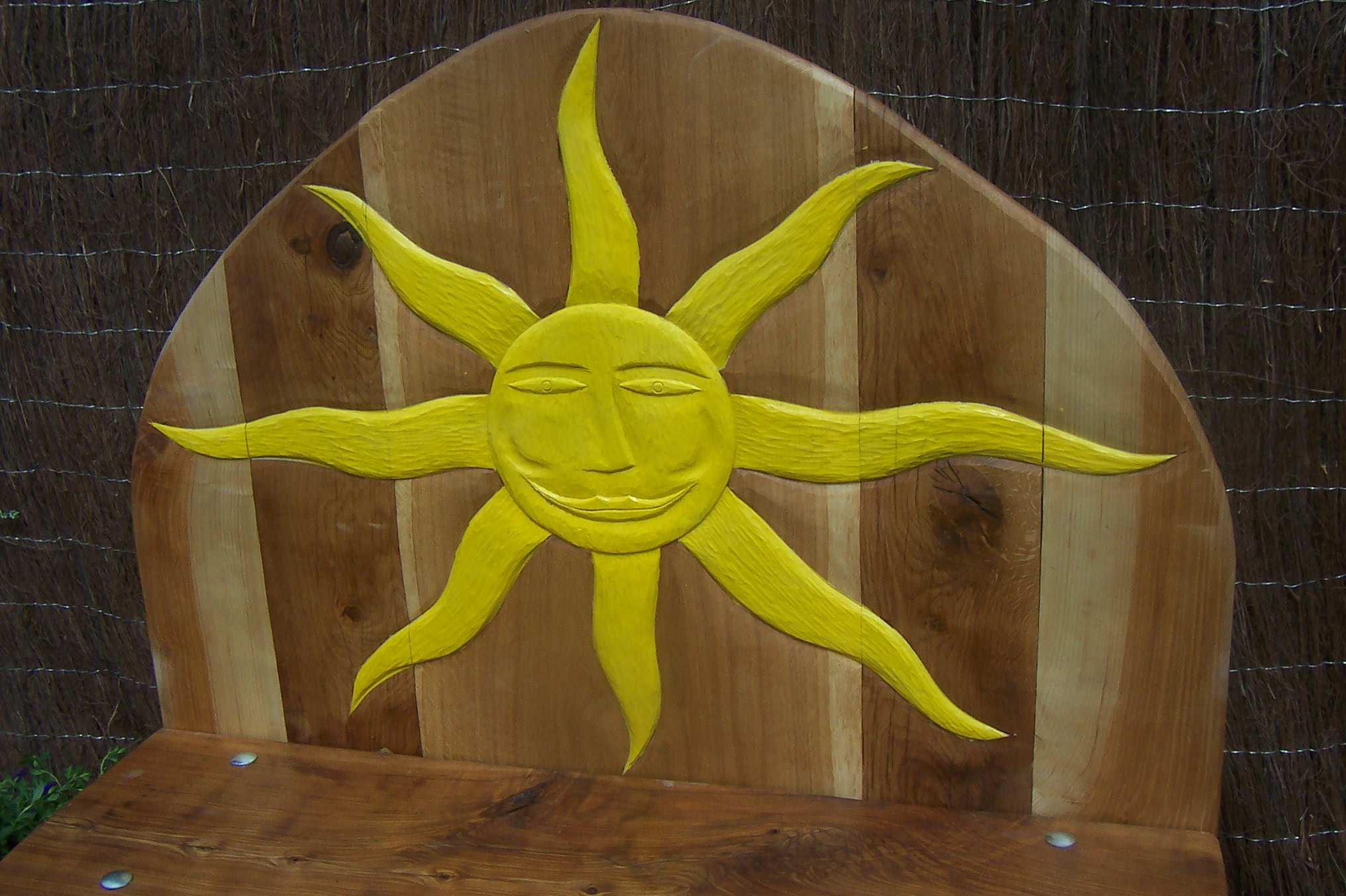 hand carved and painted sun bench seating wildchild designs