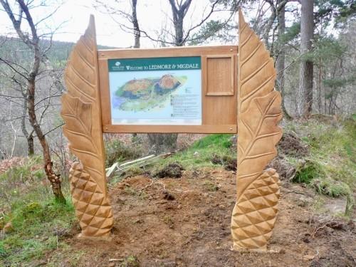 ledmore and migdale wood carved information sign wildchild designs