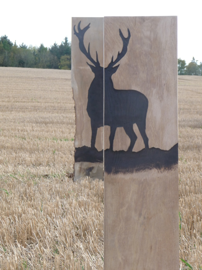 stag artwork wooden sculpture in field wildchild designs