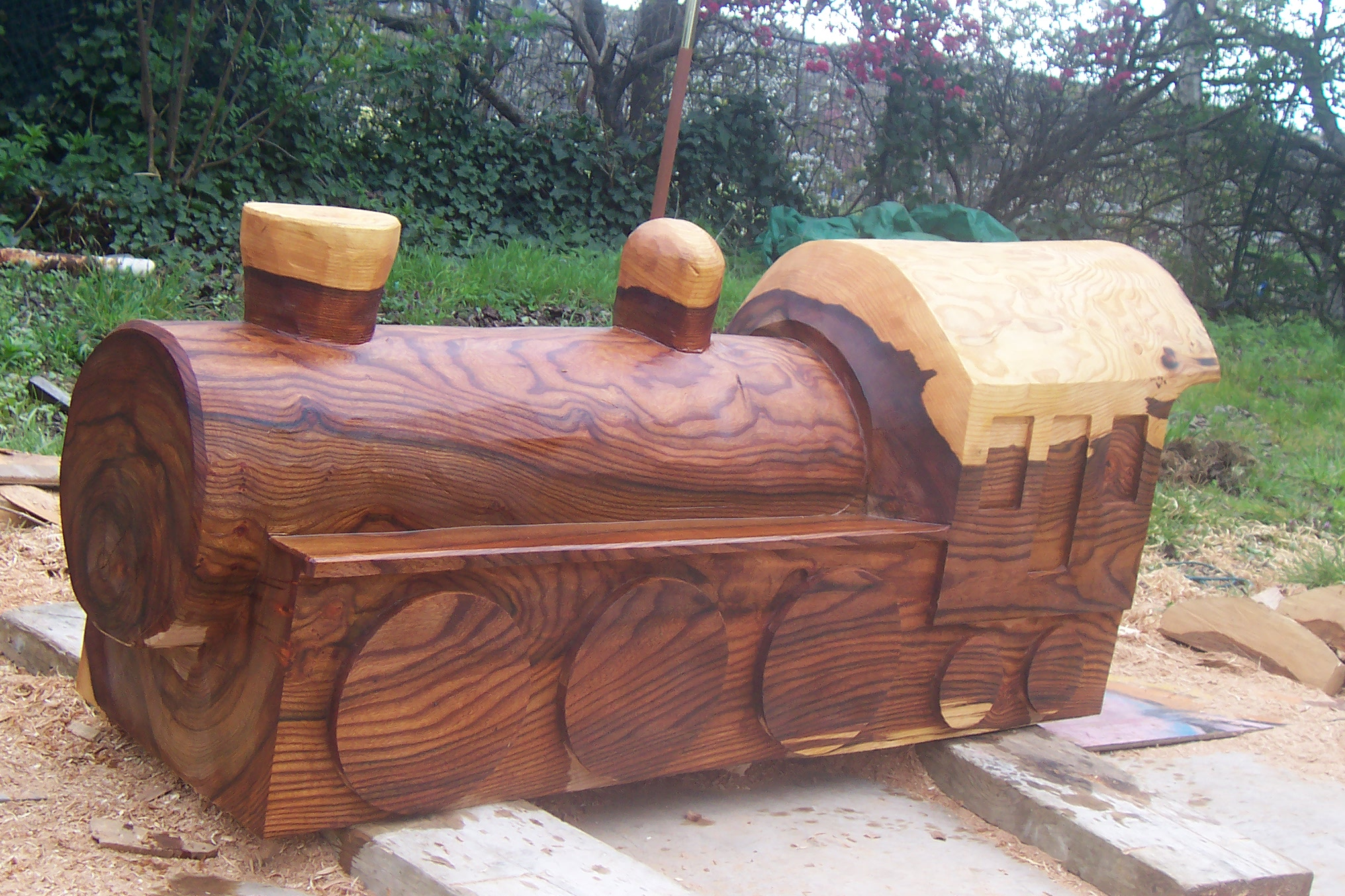 train bespoke carved wood seating wildchild designs