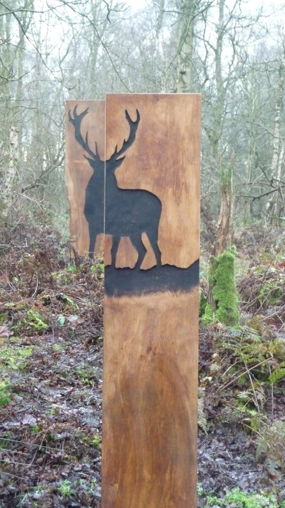 unusual stag artwork in forest wood carving wildchild designs