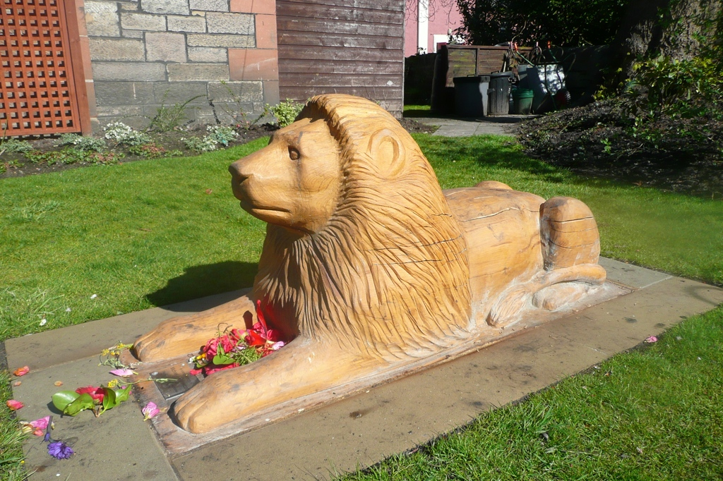 wood carved lion public sculpture wildchild designs